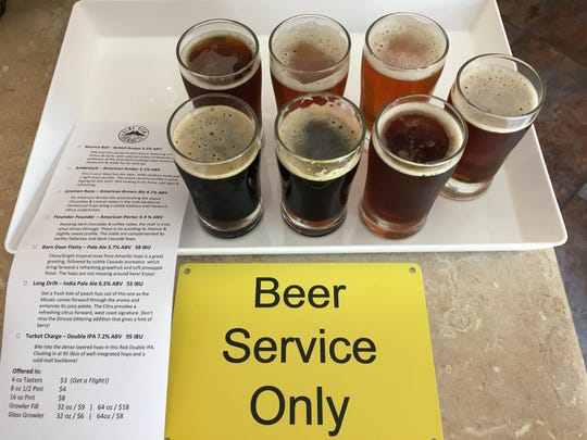 """A flight of tasters is seen at the """"beer service only"""" counter at Flat Fish Brewing Co. in Camarillo. The brewery shares an address, and owners, with Cantara Cellars."""