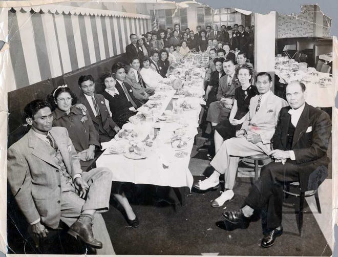 """Taken in the 1940s, this photograph of a Filipino holiday celebration will be included when """"At Table: The Business of Food and Community"""" opens Aug. 30 at the Museum of Ventura County. The exhibit will include items from long-gone restaurants, table settings representing different cultures and a panel discussion with """"Taco USA"""" author Gustavo Arellano."""