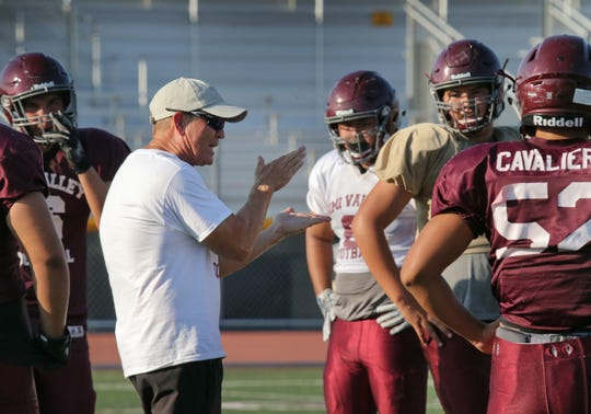 Simi Valley head coach Jim Benkert gives pointers to his Pioneers during practice.