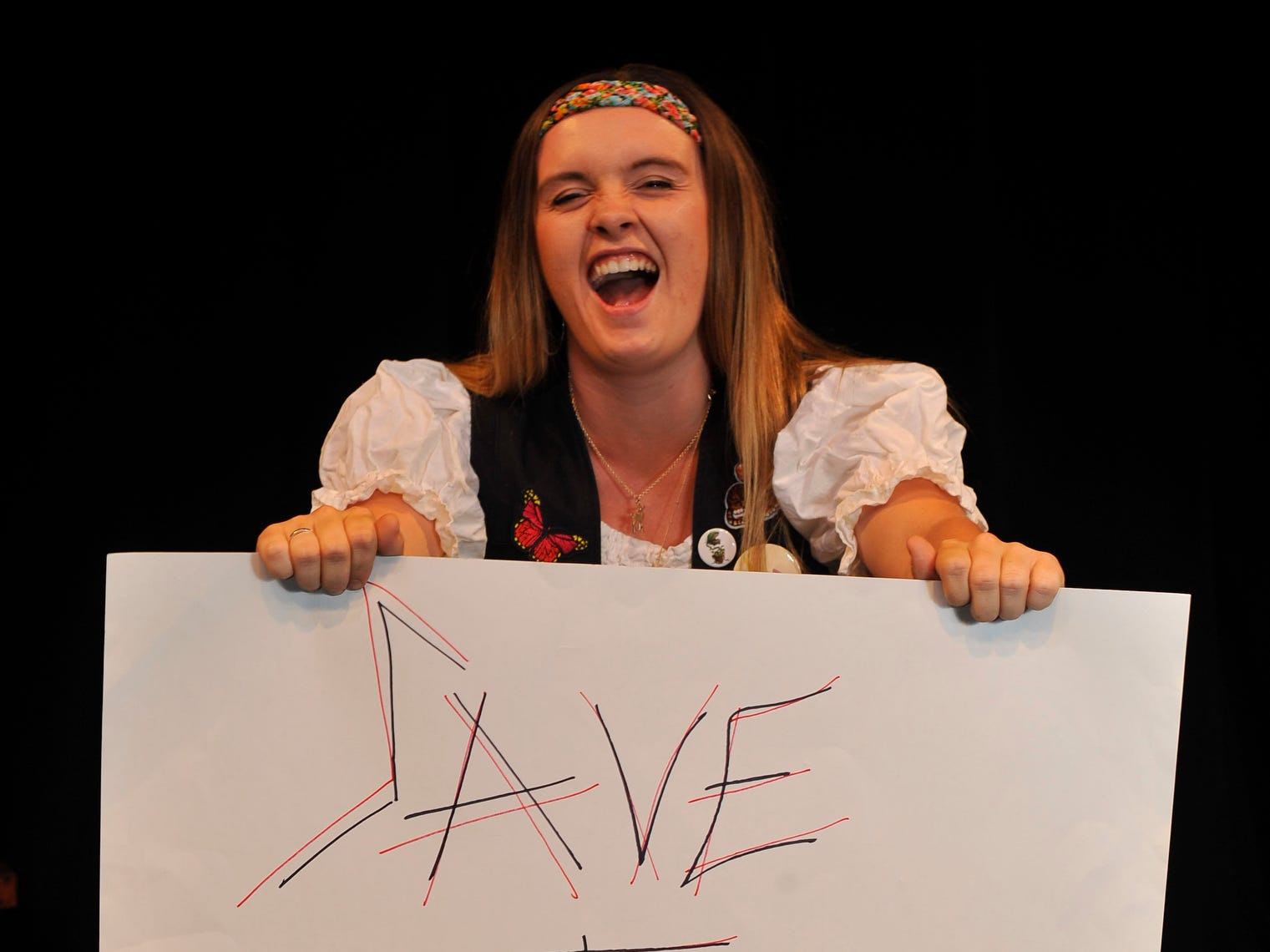 "Carly Caviglia stars in the Fourth Wall Theatre's  ""Rock of Ages."""