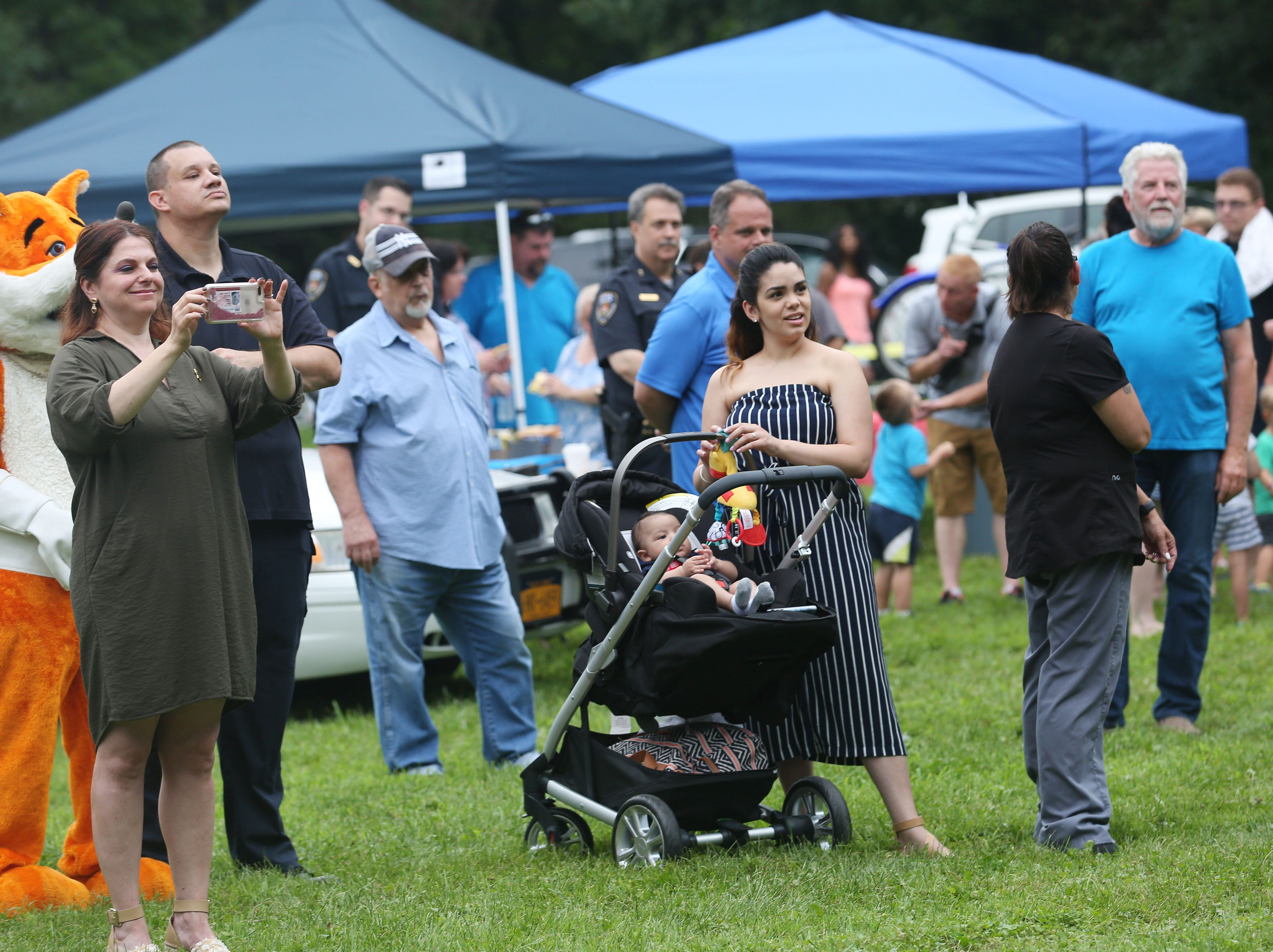 Residents of Putnam Lake enjoy the annual National Night Out at Memorial Field in Putnam Lake Aug. 7, 2018. The event is sponsored by the Putnam Lake Neighborhood Association and Putnam Lake Park District.