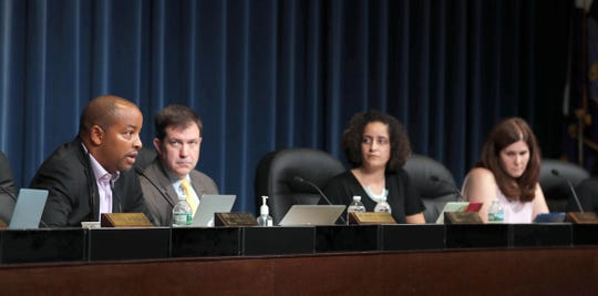 New Rochelle school board President Jeffrey Hastie speaks after reading a letter of resignation from high school Principal Reginald Richardson during a school board meeting Aug. 7.