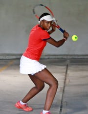 Kela Simunyola, operator of the Mount Vernon Tennis Center practices with his student, Valaine Clarke, 15, in the garage of Best Buy in Mount Vernon Aug. 7, 2018.