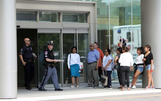 Visitors wait outside Westchester Medical Center as police respond to reports of shots fired Wednesday.