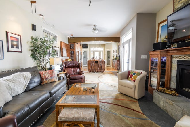 The living room at 1521 N. Adams St.  features heated concrete floors and a gas fireplace.