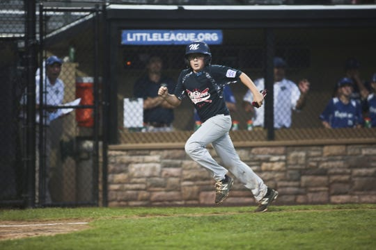 Milton base runner Tyler Jacona heads for home scoring the only run against Pennsylvania. Milton lost to Pennsylvania 6-1.