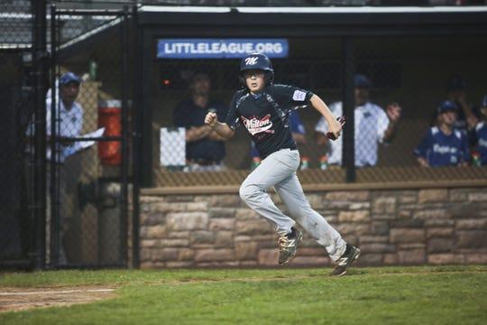 Milton base runner Tyler Jacona heads for home scoring the only run against Pennsylvania. Milton lost to Pennsylvania 6-1.