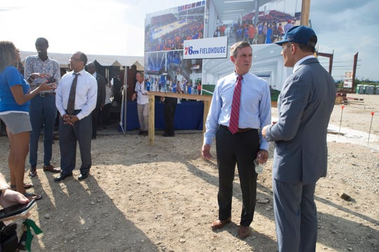 Delaware Governor John Carney, left, speaks with Robert Buccini during the groundbreaking celebration for the 76ers Fieldhouse Wednesday near the Riverfront. The sports complex will be the new home for the 76ers NBA G League team the Delaware Blue Coats.