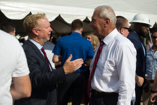 76ers President of Business Operations Chris Heck, left, speaks with Wilmington Mayor Mike Purzycki during the groundbreaking celebration for the 76ers Fieldhouse Wednesday near the Riverfront. The sports complex will be the new home for the 76ers NBA G League team the Delaware Blue Coats.
