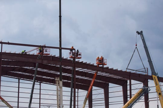 Construction crews work on the new 76ers Fieldhouse Wednesday near the Riverfront in Wilmington.