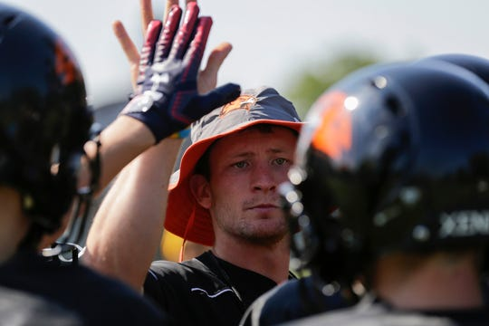 Port Edwards football coach Max Ayres high-fives a player during Wednesday's practice at Port Edwards High School.