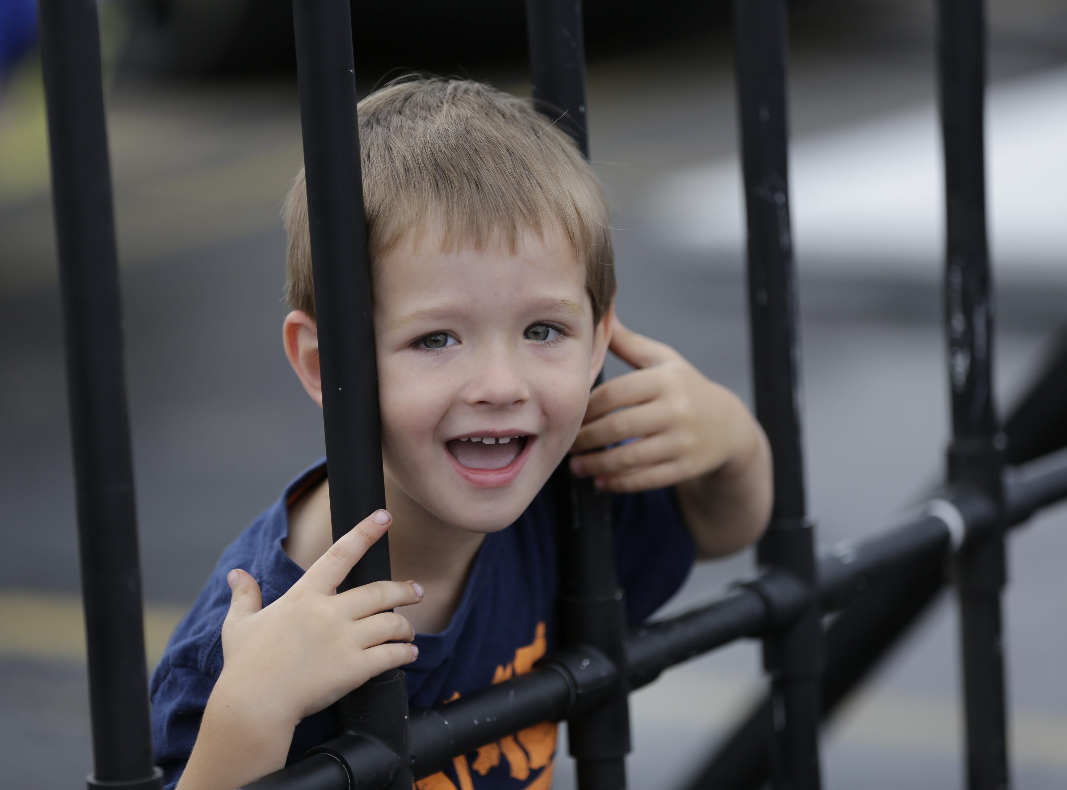 Nolen Pankowski, 3, pretends to be locked up behind fake jail cell bars during the National Night Out event put on by the Wisconsin Rapids Police Department in the Crossview Church parking lot in Wisconsin Rapids Tuesday, August 7, 2018.