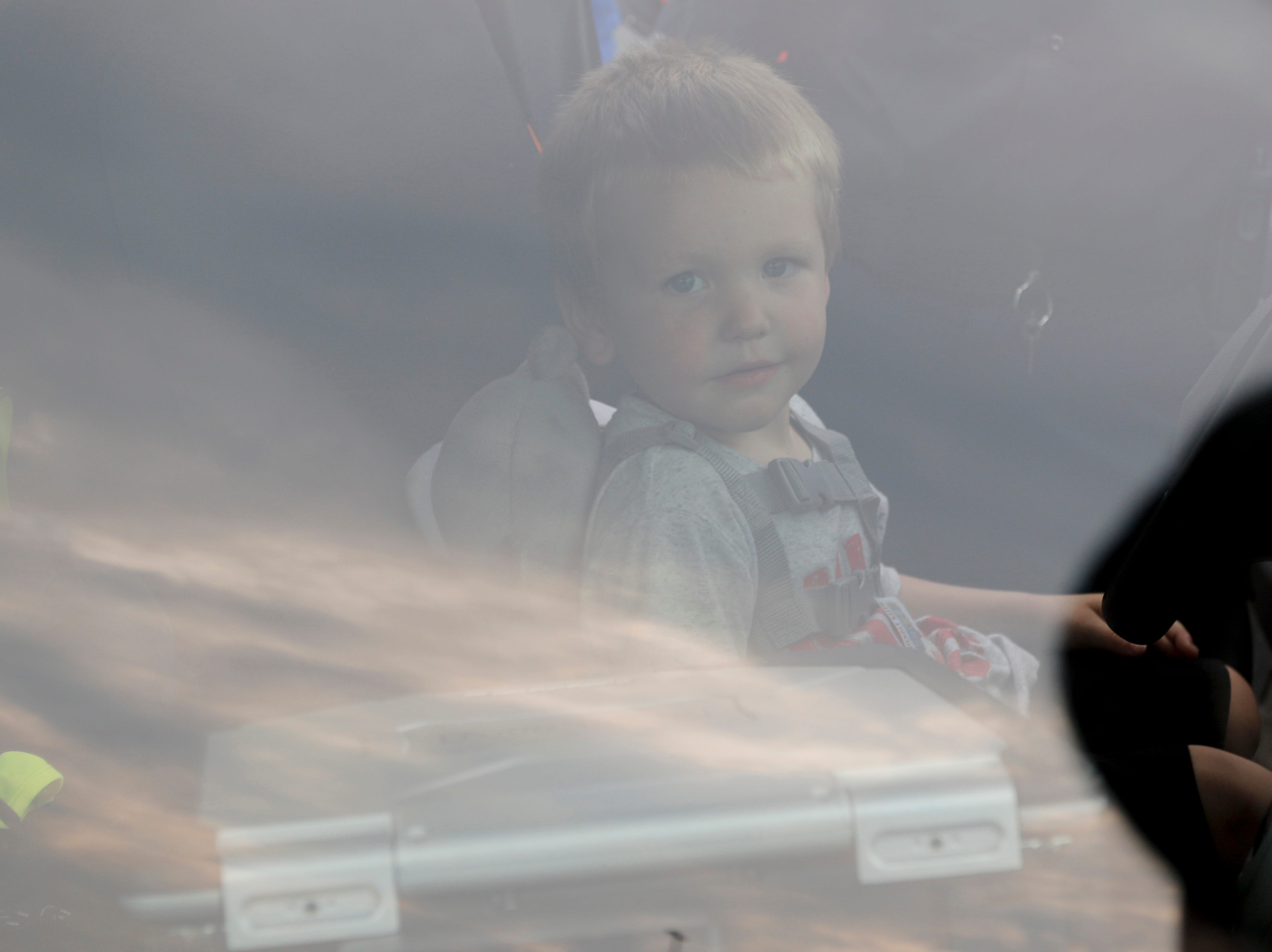 Jaithan Walters, 3, sits inside of a Wisconsin Rapids Police Department squad car during the National Night Out event put on by the Wisconsin Rapids Police Department in the Crossview Church parking lot in Wisconsin Rapids Tuesday, August 7, 2018.