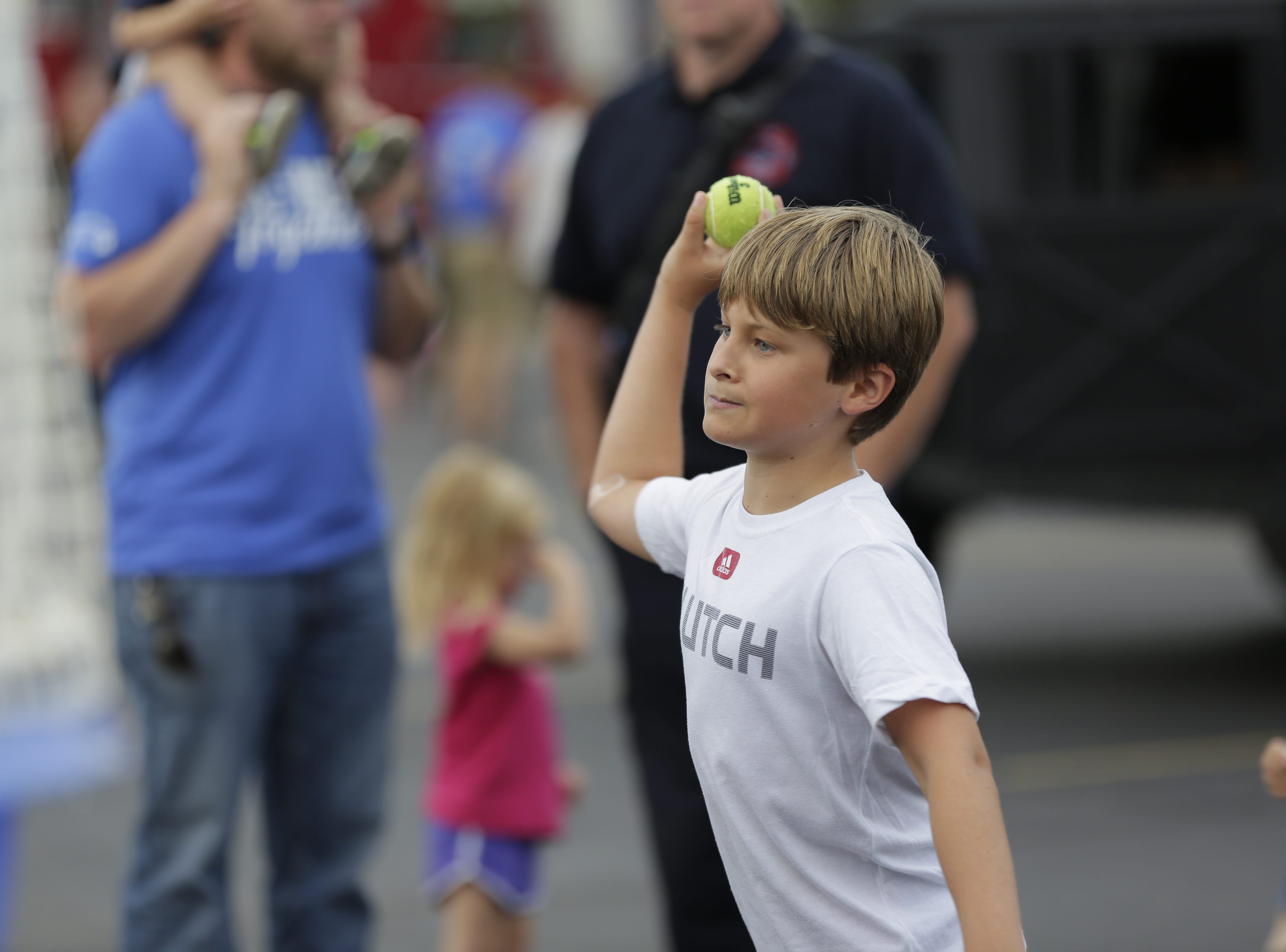 Sam Gasch, 10, throws a ball at the dunk tank during the National Night Out event put on by the Wisconsin Rapids Police Department in the Crossview Church parking lot in Wisconsin Rapids Tuesday, August 7, 2018.