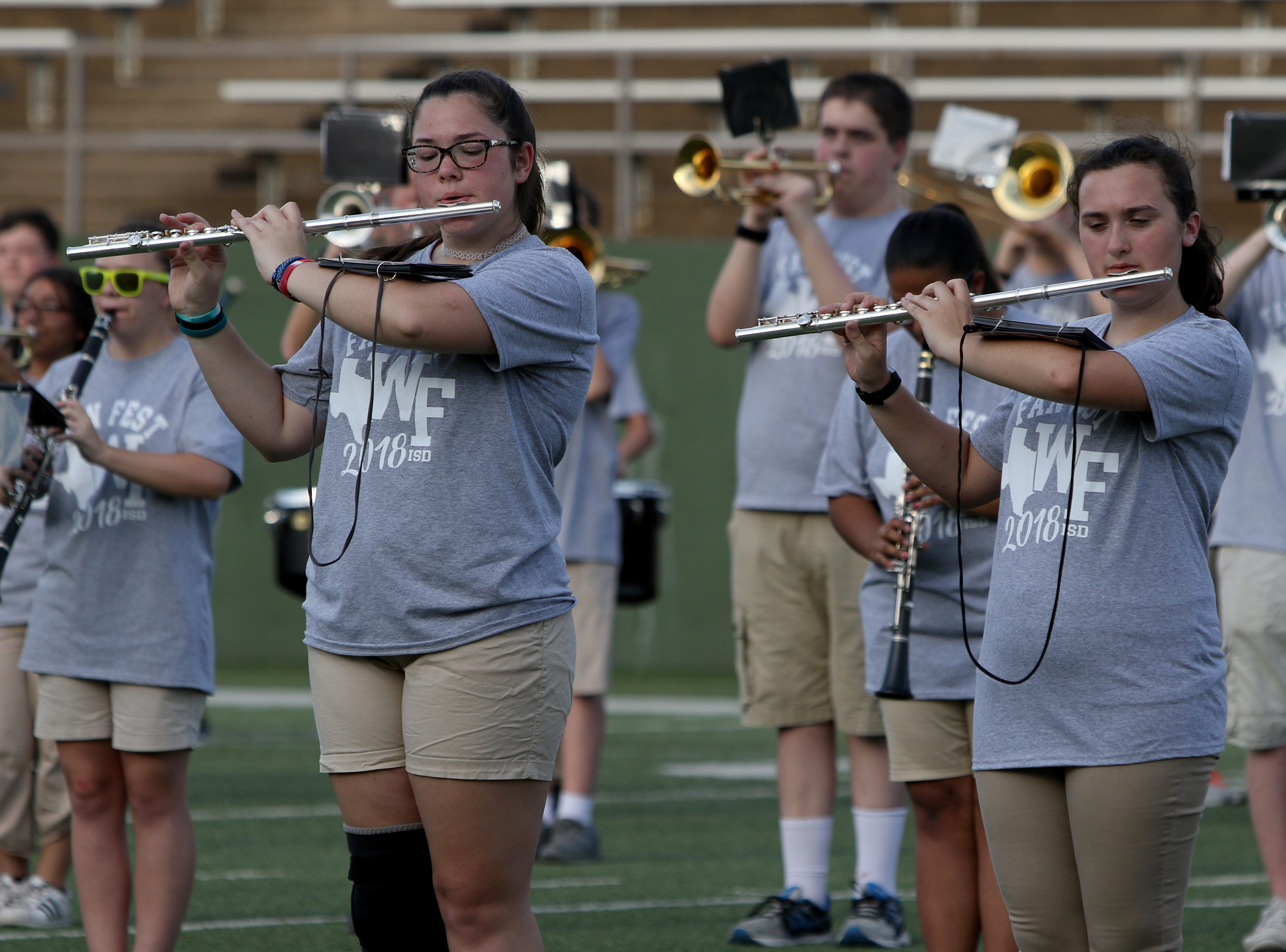 The combined Hirschi, Rider and Wichita Falls High School bands perform at the WFISD Fan Fest Tuesday, Aug. 7, 2018, at Memorial Stadium.