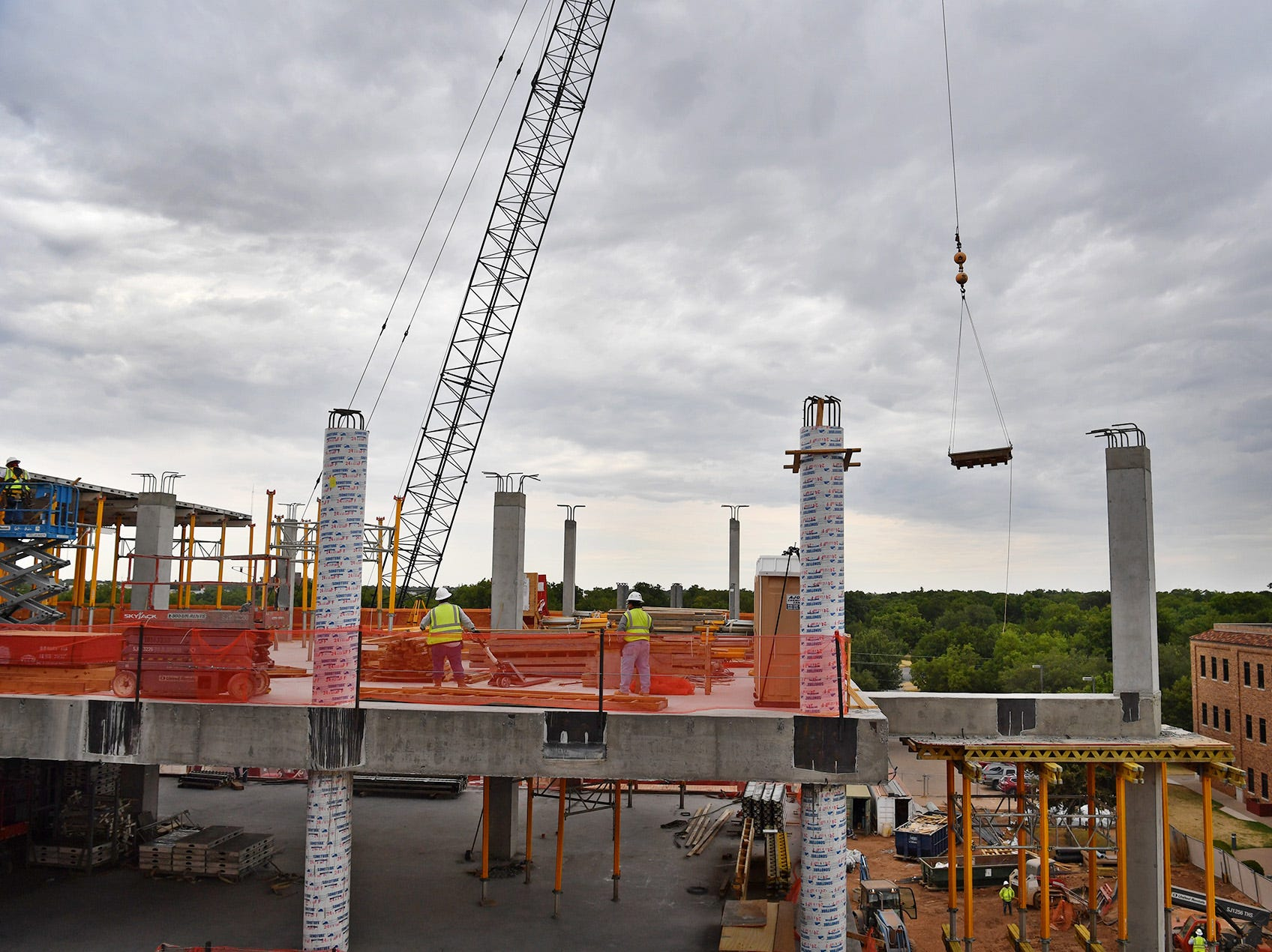 Construction of the Midwestern State University Health Sciences and Human Services building is topping out as workers install forms for the roof of the four-story building.