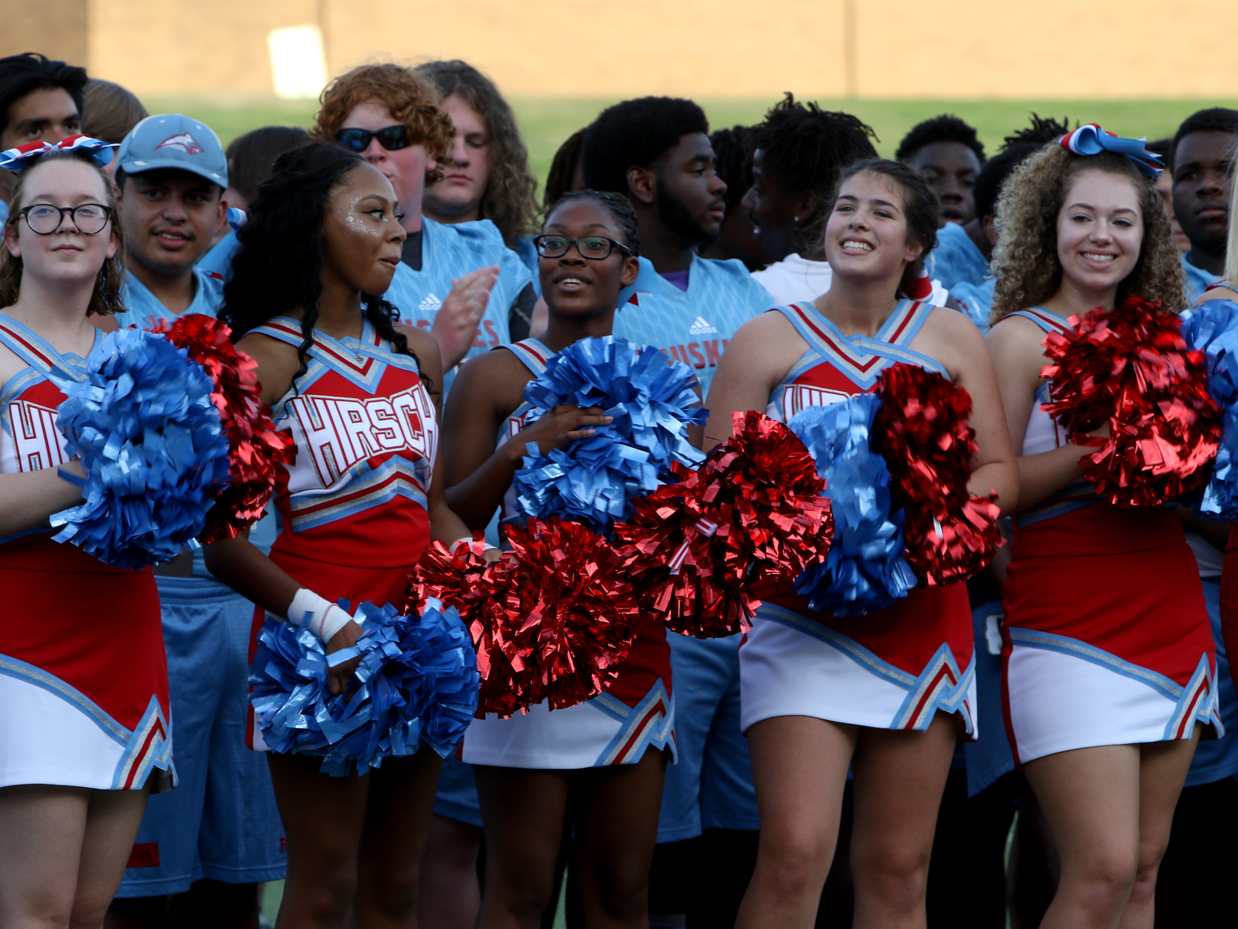 Hirschi cheerleaders watch the speakers at the WFISD Fan Fest Tuesday, Aug. 7, 2018, at Memorial Stadium.