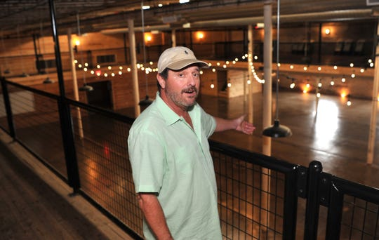 File - The Warehouse, co-owner, Steve Wilkinson shows an area at his event center
