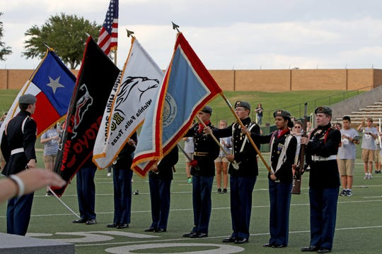 Members of the ROTC from the three high schools present the colors for the National Anthem at the WFISD Fan Fest Tuesday, Aug. 7, 2018, at Memorial Stadium.