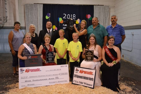 Amy Ryan (center) joined by her sons Dylan and Cameron Ryan, showed the winning 2 year old, Ryan-Vu Atwood Ithaca-ET at the 2018 Agromatic Holstein Futurity at the Fond du Lac County Fair. Joining them (front row from left) Emily Franke, 2018 FDL Co. Fairest of the Fair; Allie Breunig, Wisconsin Holstein Princess; Brooke Trustem, Wisconsin Holstein Princess Attendant; Kaitlyn Riley, 2018 Alice in Dairyland. Back row from left, Mary Schuster, award sponsor; Connie Julka, award sponsor; Ryan Weigel, judge; Dean Birschbach, major sponsor; and Jim Gillett, award sponsor.