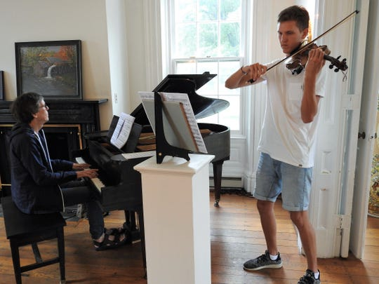 Fritz Schwinghammer and his son, Leopold, rehearse for a concert Saturday at the Pomerene Center for the Arts part of the Coshocton Arts Homecoming. Fritz, of Germany, is nephew of Reni Akers of Coshocton.