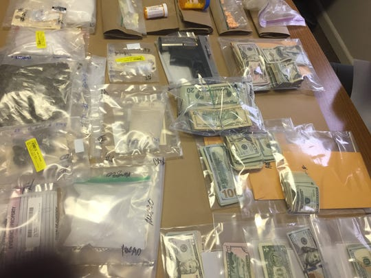 About $60,000 in cash was seized during a Tuesday morning drug raid in Zanesville.