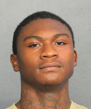 This undated photo provided by the Broward's Sheriff's Office shows Trayvon Newsome. The fourth suspect in the shooting death of emerging South Florida rap star XXXTentacion has turned himself into authorities.