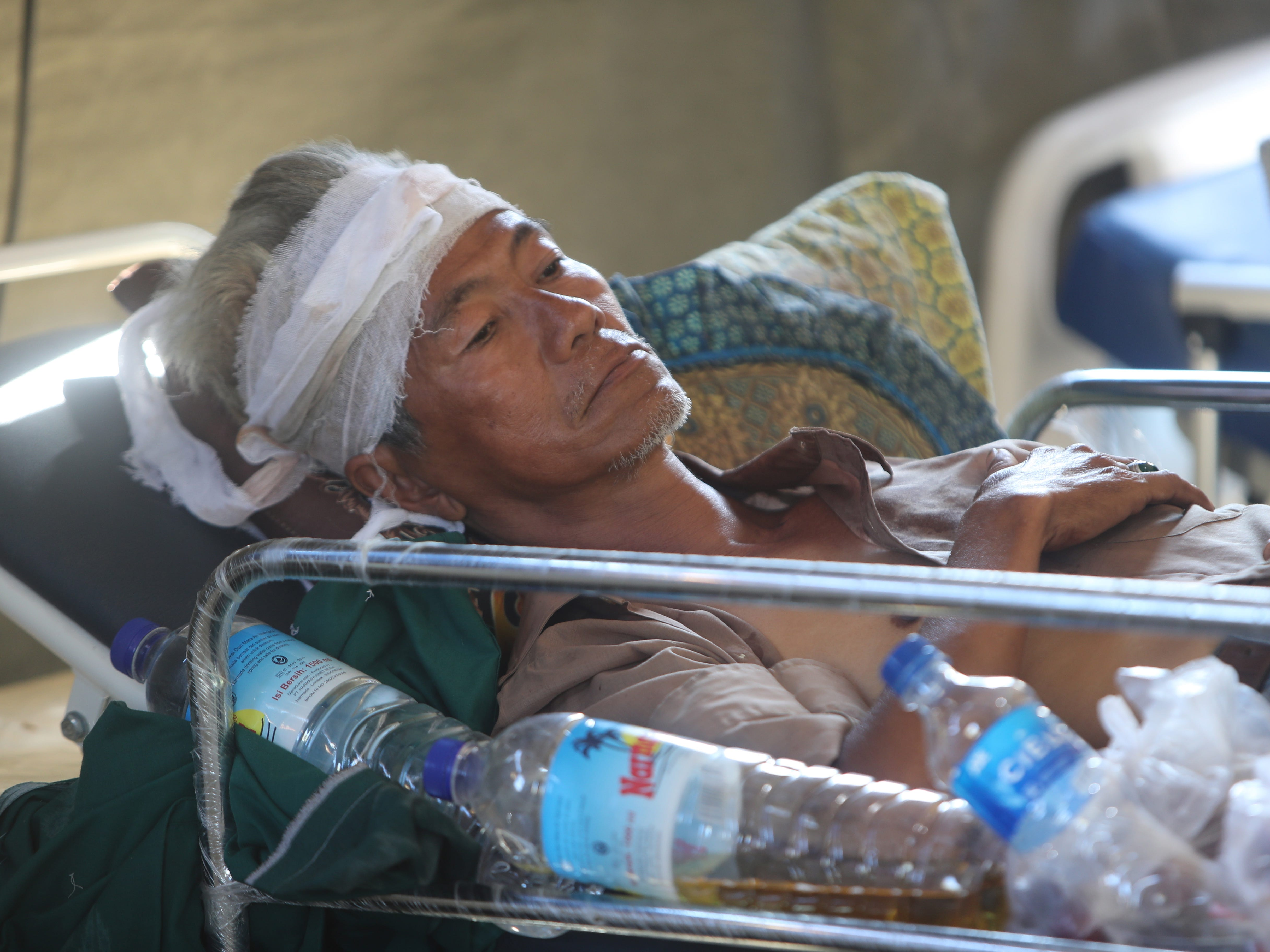A survivor sleeps at an emergency hospital in Tanjung, northern Lombok, West Nusa Tenggara, Indonesia on Aug. 8, 2018.