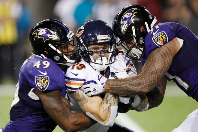 Kamalei Correa #51 and Chris Board #49 of the Baltimore Ravens are called for an illegal hit while tackling Tanner Gentry #19 of the Chicago Bears in the third quarter of the Hall of Fame Game at Tom Benson Hall of Fame Stadium on August 2, 2018 in Canton, Ohio.
