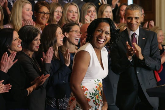 National Teacher of the Year Jahana Hayes of John F. Kennedy High School in Waterbury, Conn., takes the stage with President Barack Obama and her fellow state teachers of the year during a ceremony in the East Room of the White House May 3, 2016, in Washington, D.C.