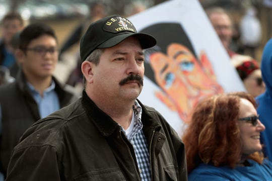 Randy Bryce joins other residents at a rally to show support for students who finished the last leg of a 50-mile march through Wisconsin in the hometown of House Speaker Paul Ryan to call attention to gun violence on March 28, 2018, in Janesville, Wisconsin.