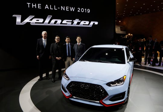 From left, Albert Biermann, head of performance development for the Hyundai Motor Group, Chief Designer Peter Schreyer, President and CEO of Hyundai Motor America Kenny Lee and Hyundai Vice Chairman Moosik Kwan, stand next to the 2019 Veloster N model during the North American International Auto Show in Detroit.