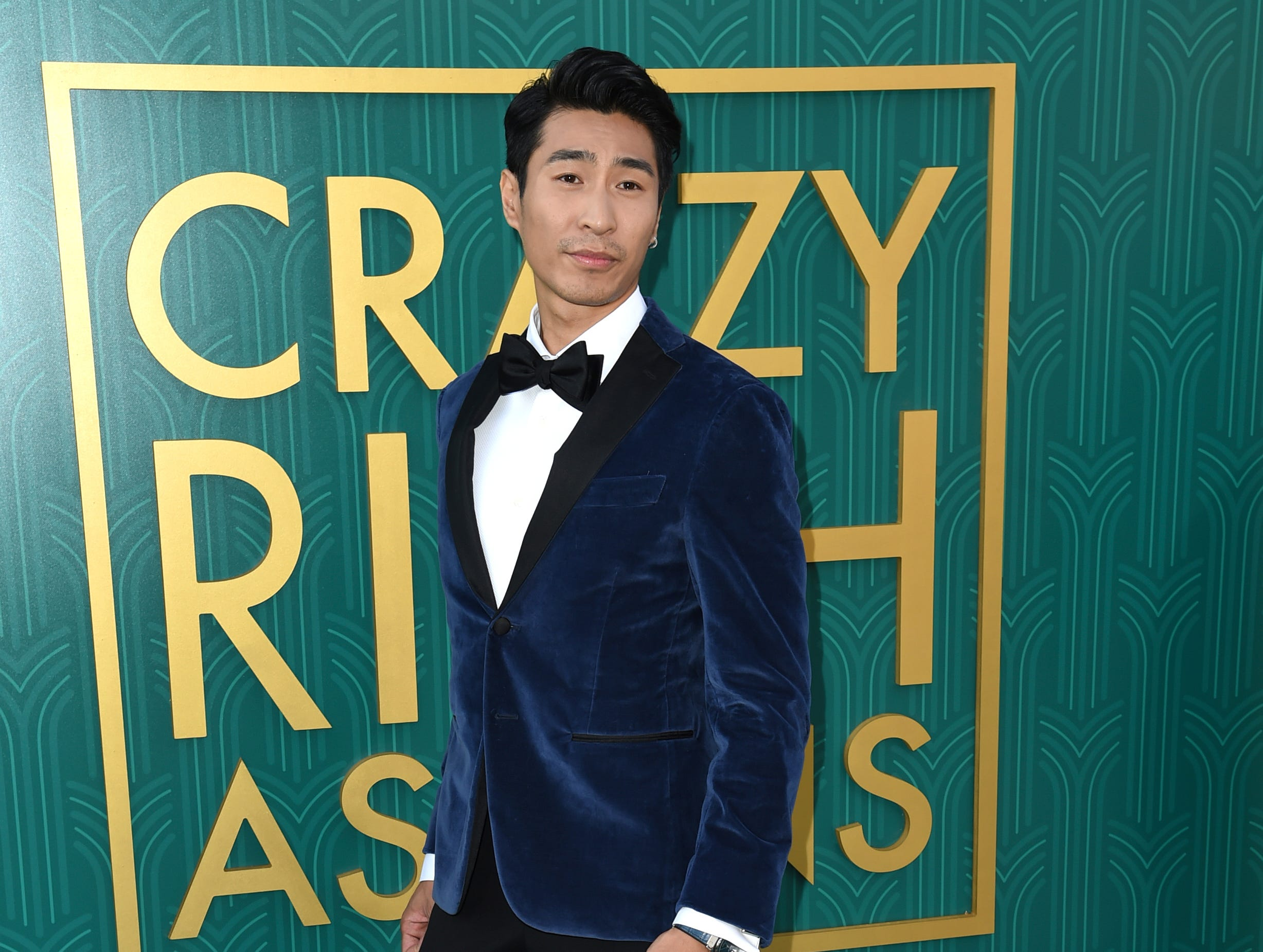 "Chris Pang wore a blue velvet jacket and a bow tie at the premiere of ""Crazy Rich Asians."" The actor brings Nick's cousin to life on the big screen."