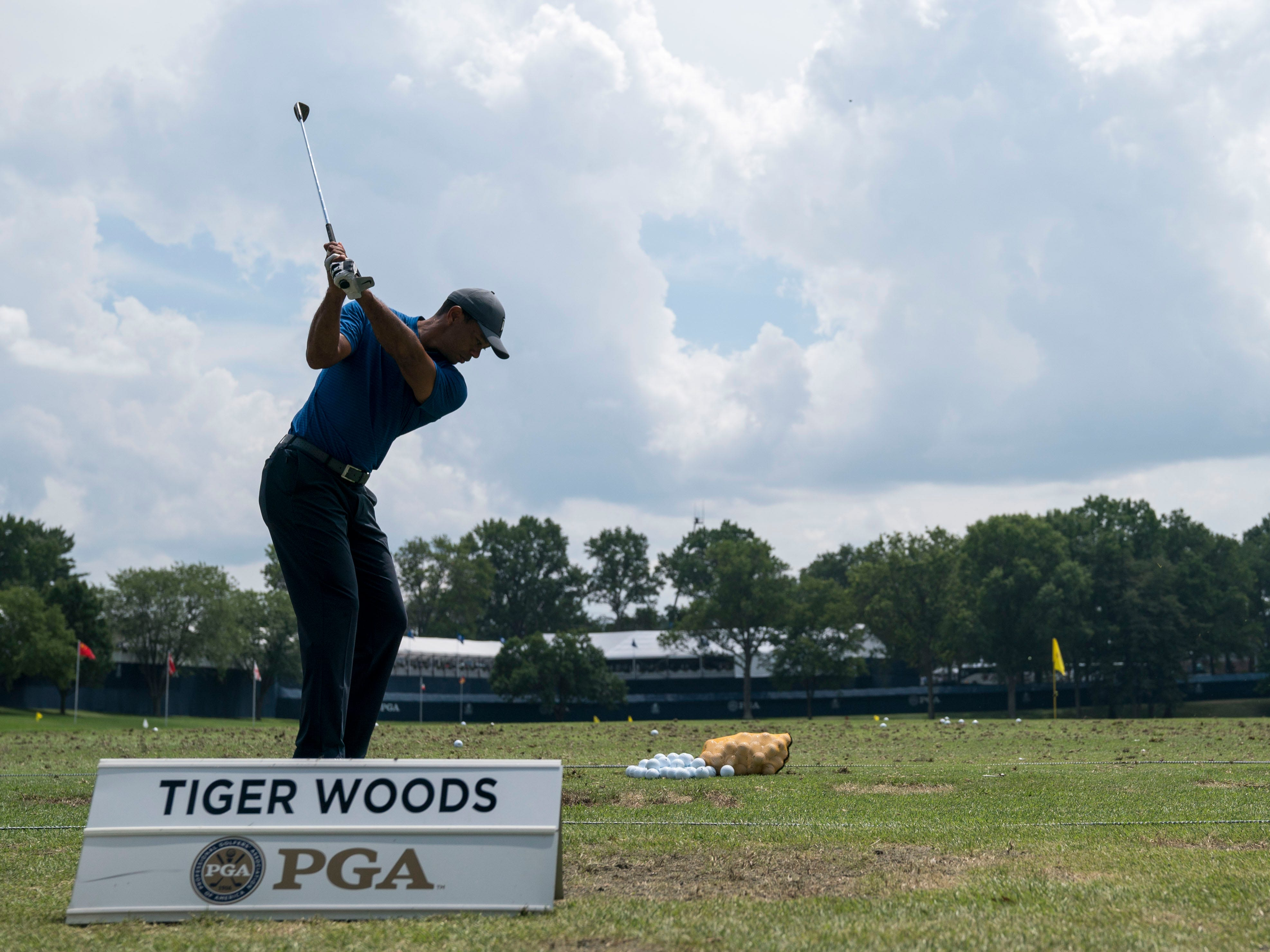 Tiger Woods warms up on the driving range.
