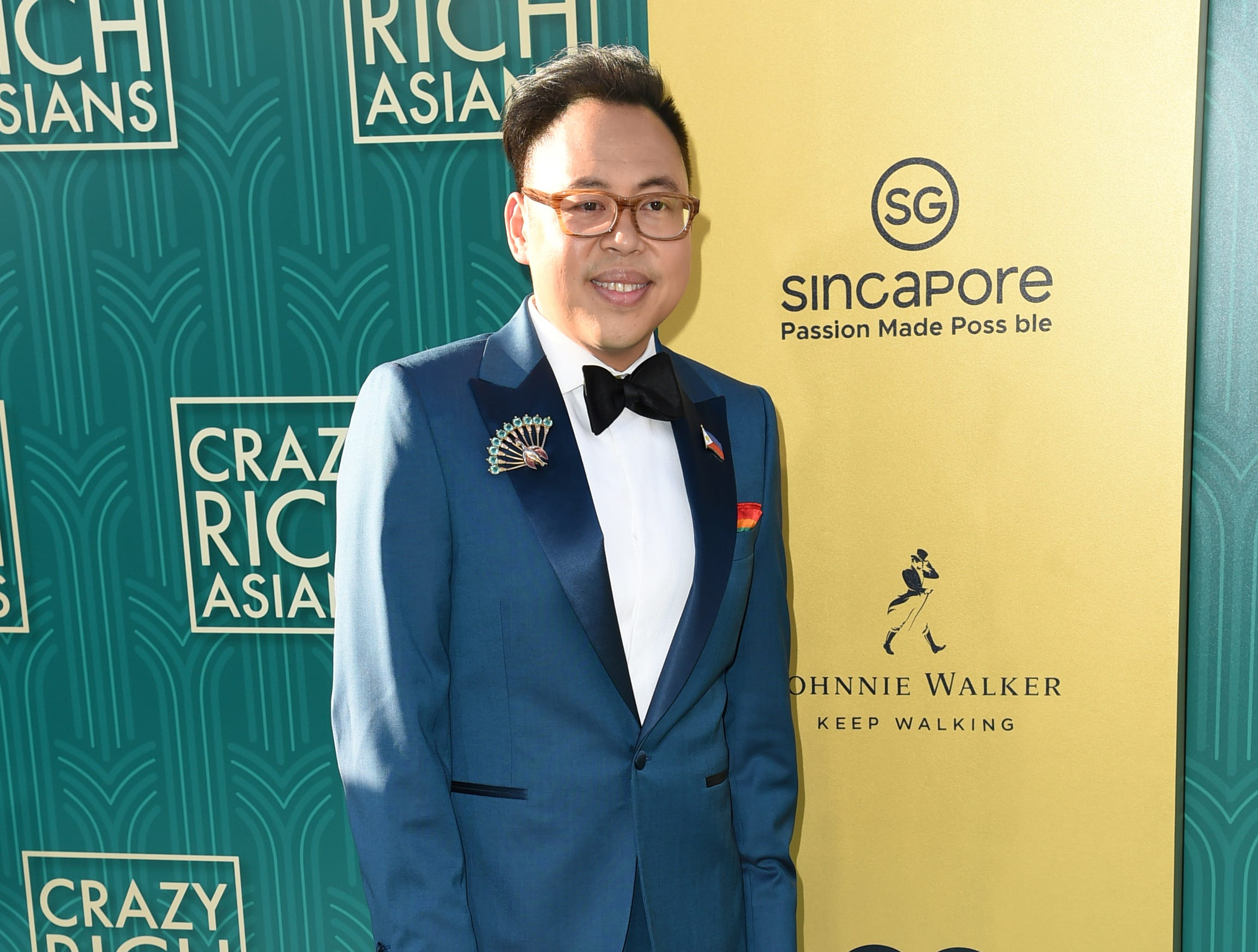 "Nico Santos, who play's one of Nick's family members, wore nearly matched the red carpet at the premiere of ""Crazy Rich Asians."""