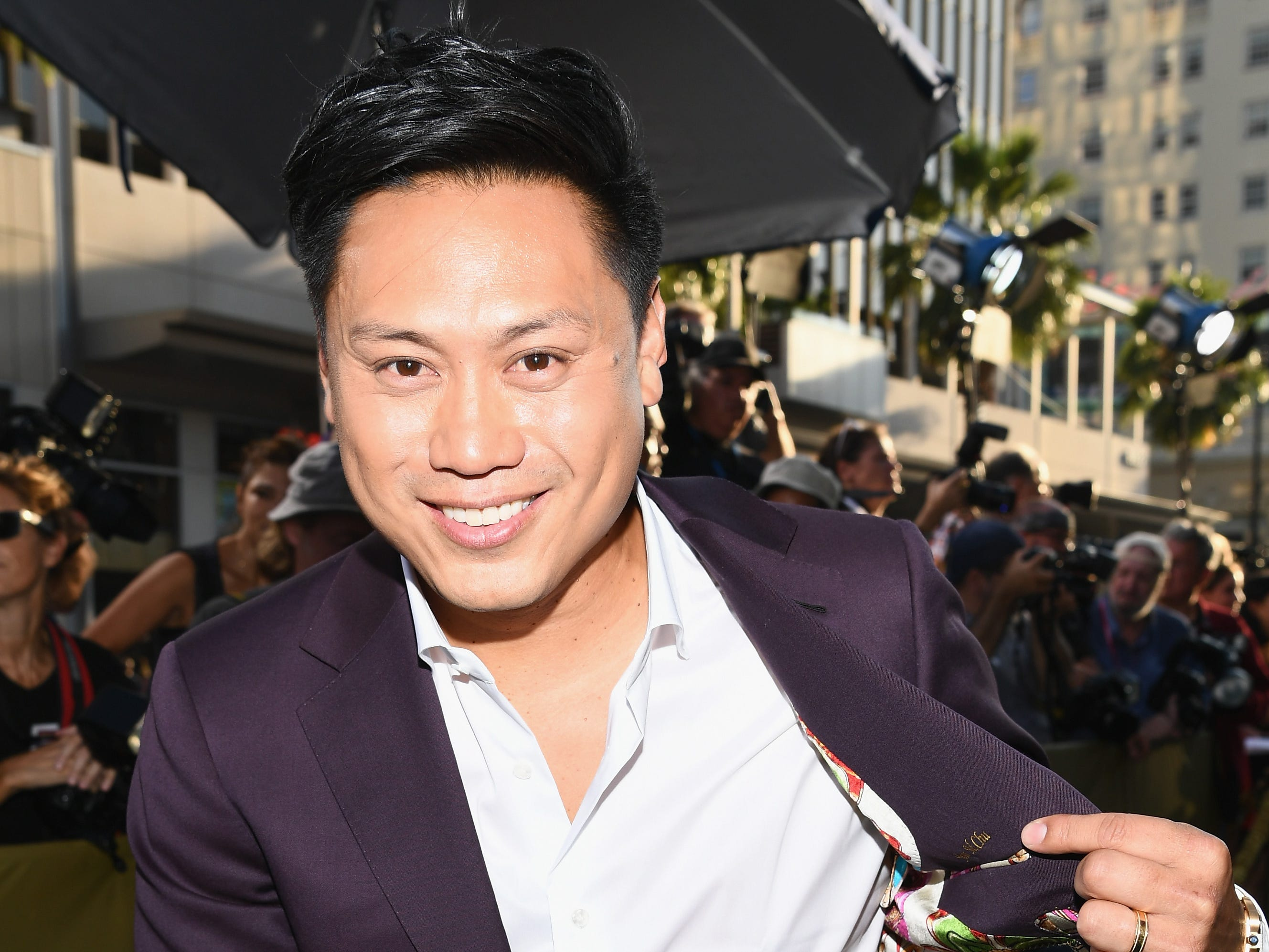 "Jon M. Chu revealed a pop of color at the ""Crazy Rich Asians"" premiere."
