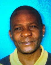 This photo provided by the Houston Police shows Jean Pierre Ndossoka. Ndossoka, suspected of fatally stabbing his children in Houston has been hospitalized after police found him with a self-inflicted gunshot wound in his car.