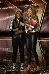 Flau'jae and host Tyra Banks on 'America's Got Talent'