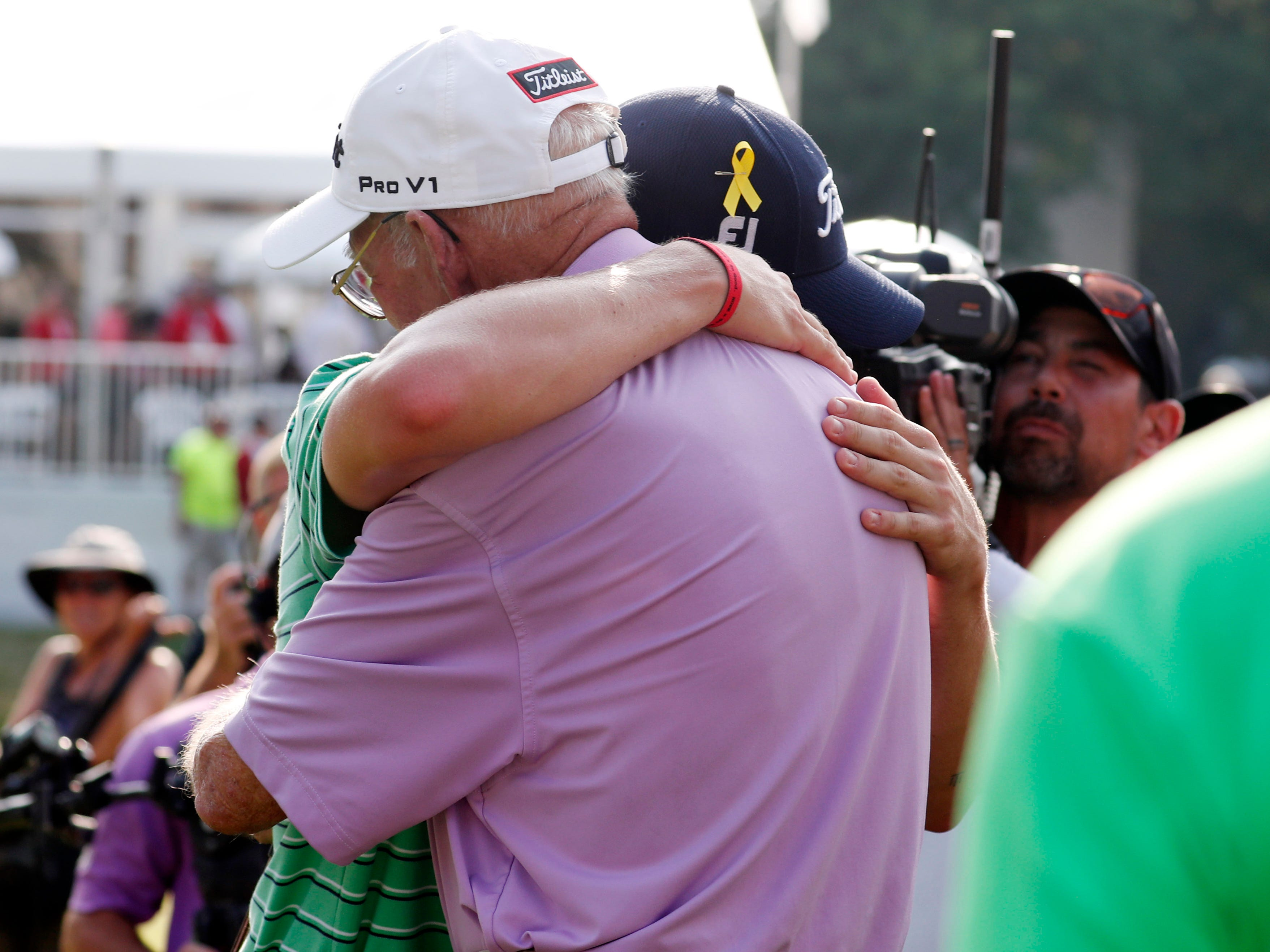 Justin Thomas hugs his grandfather Paul after winning the WGC-Bridgestone Invitational on Aug. 5.