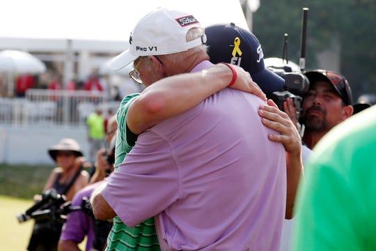 Justin Thomas hugs his grandfather Paul after winning the WGC-Bridgestone Invitational on Aug. 5.