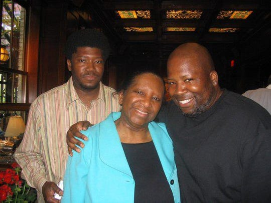 Jeanette Nelson, center with her two sons, George Everett Nelson, left, and Duane Nelson, right.