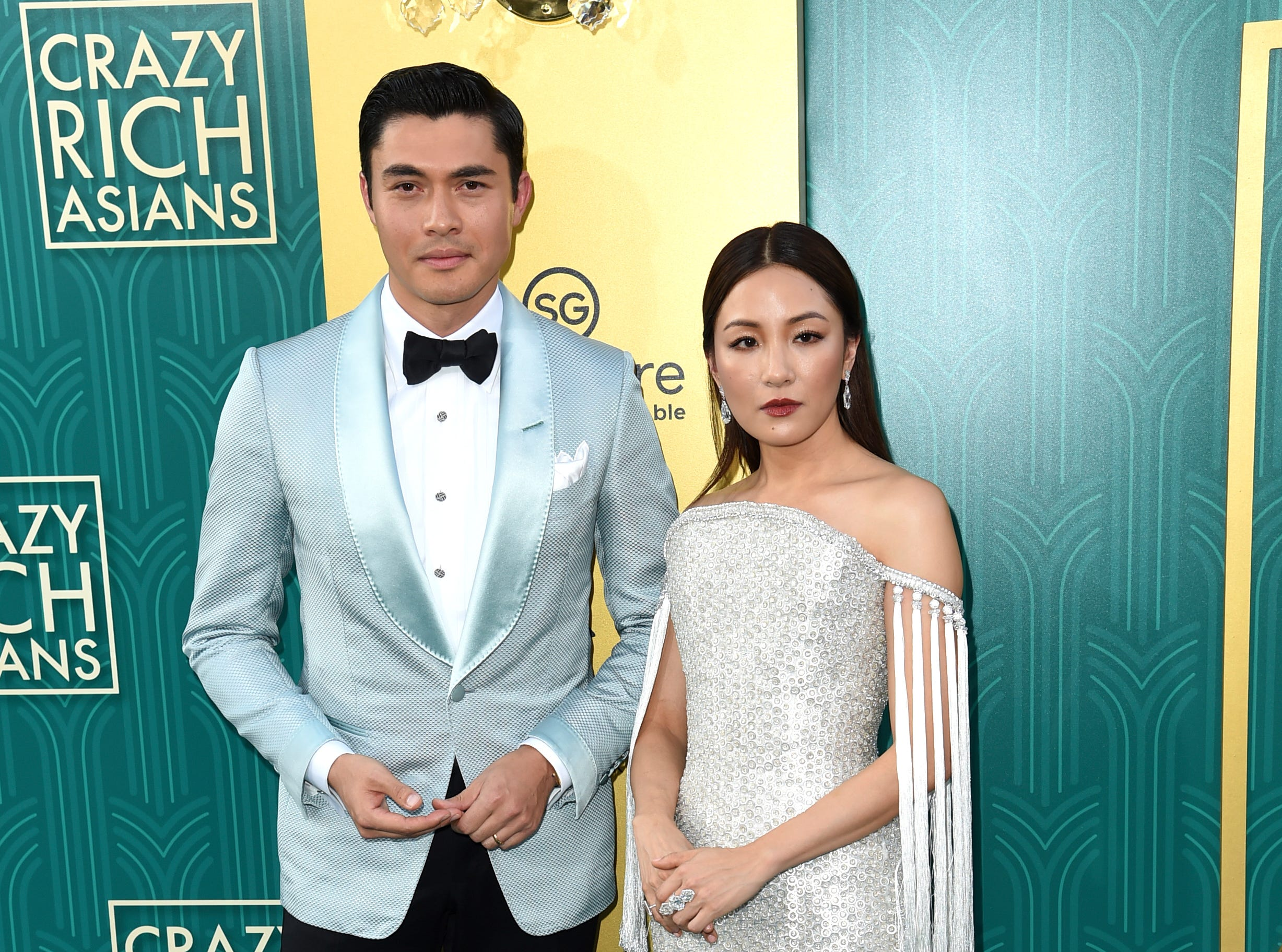 The highly anticipated romantic comedy, based on Kevin Kwan's best-selling book series, follows the story of NYU economics professor Rachel Chu (played by Constance Wu, right) going to meet her secret billionaire boyfriend's parents in Singapore (portrayed by Henry Golding, left).