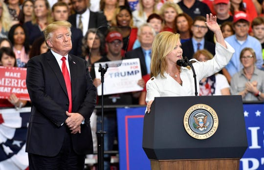 U.S. Senate candidate Marsha Blackburn speaks to the crowd as President Donald Trump looks on during his rally at Municipal Auditorium in Nashville.