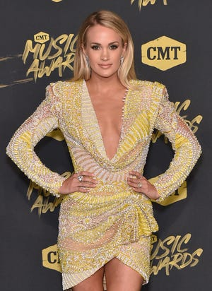 Carrie Underwood has revealed she is expecting.
