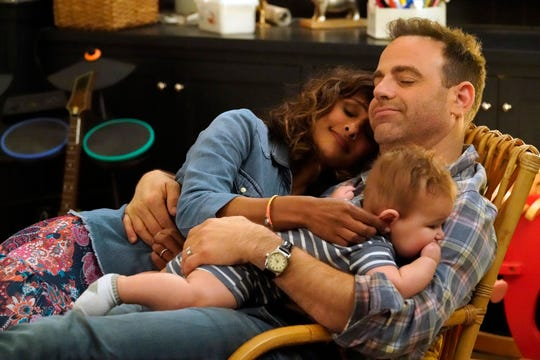 Sarayu Blue, left, and Paul Adelstein play a married couple with children in the new NBC comedy, 'I Feel Bad.'