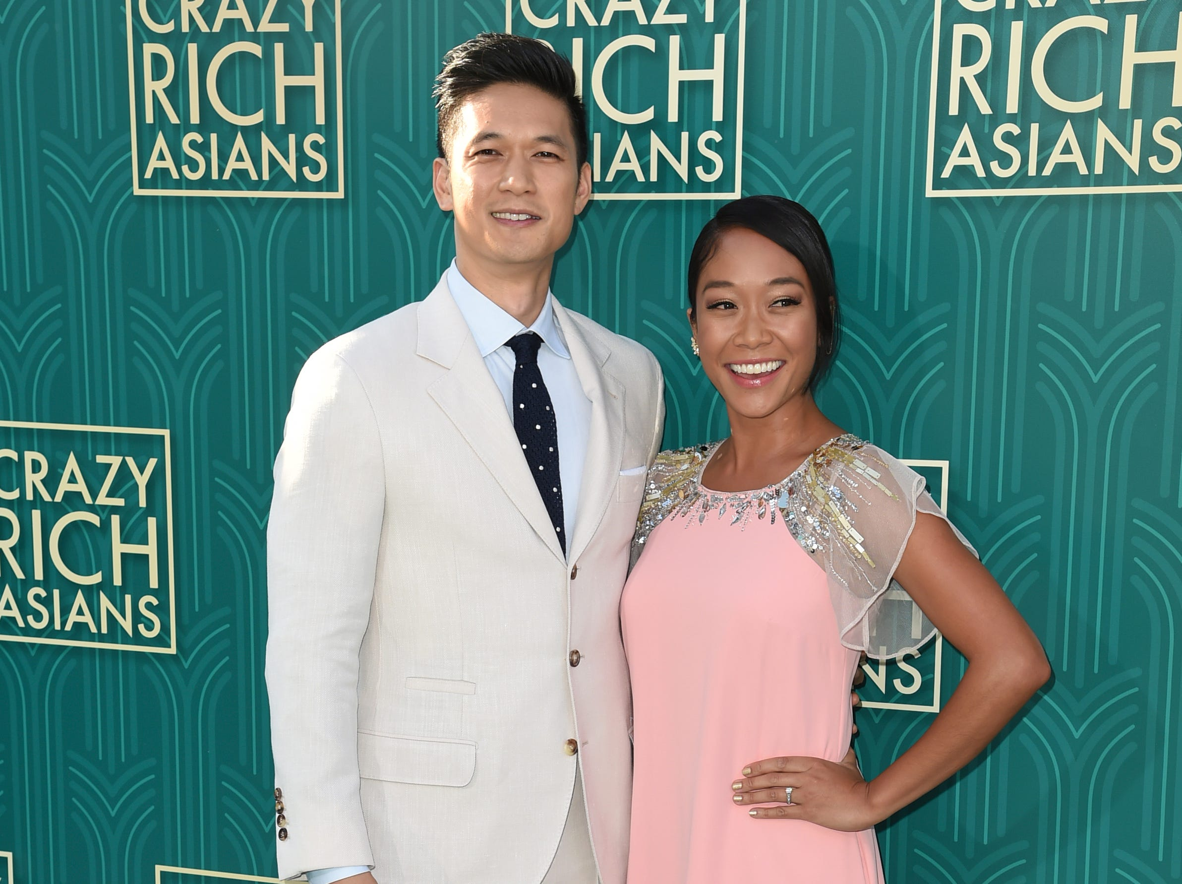"Harry Shum Jr., left, and Shelby Rabara posed at the premiere of ""Crazy Rich Asians."""