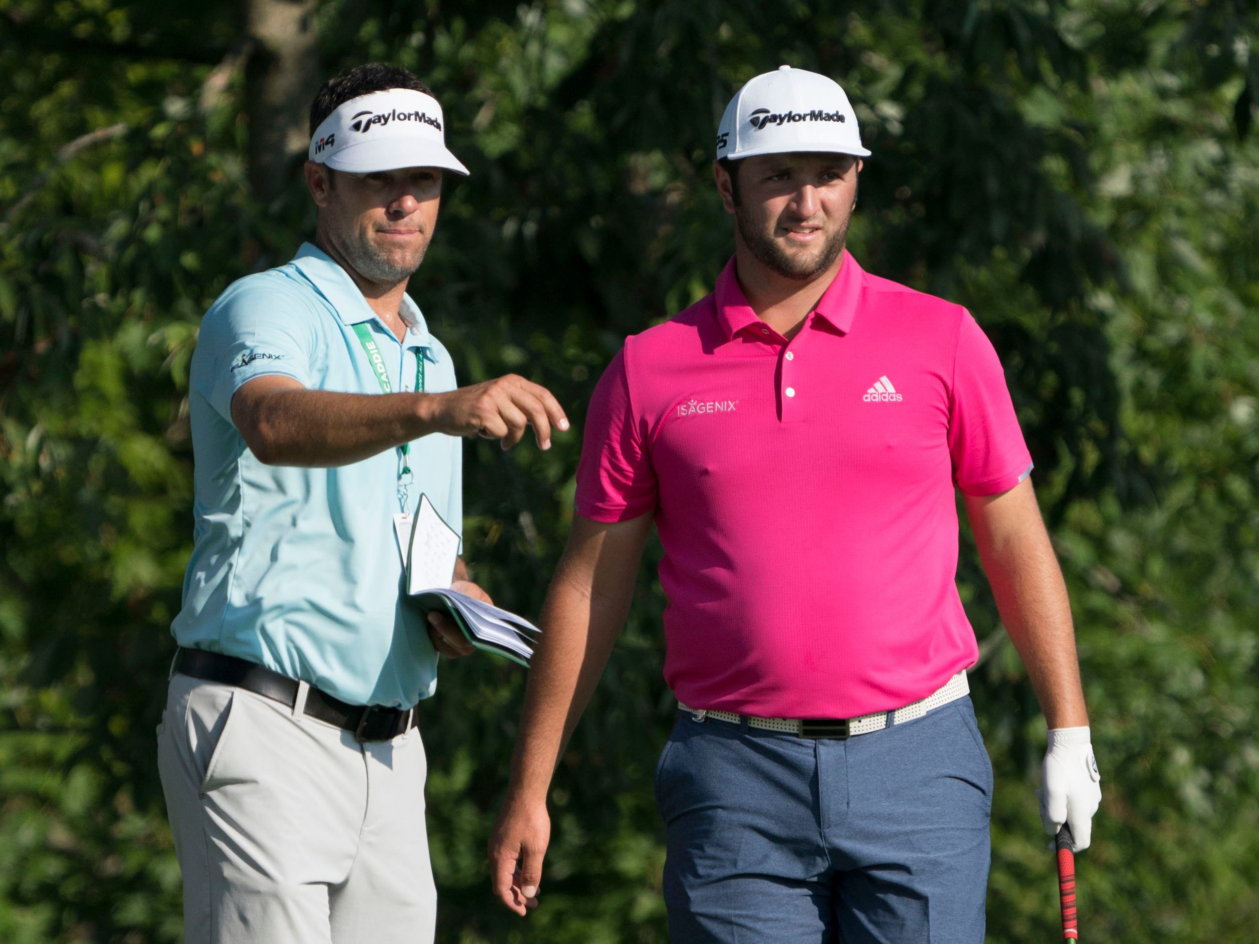Jon Rahm (right) and caddie Adam Hayes at the No. 8 tee.