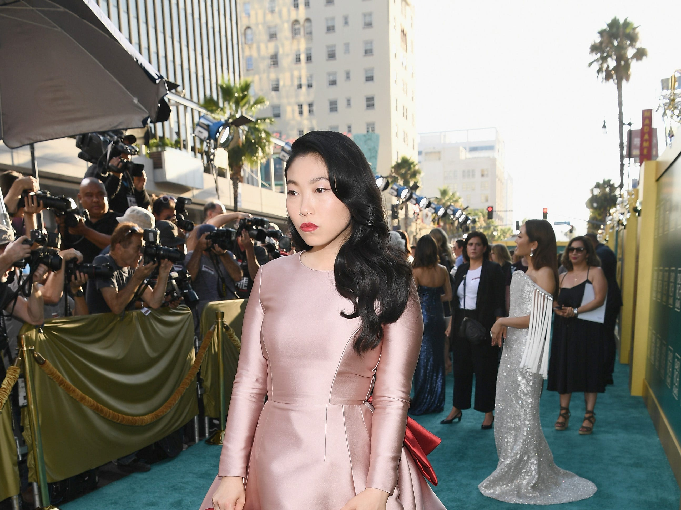 "Awkwafina was pretty in pink on the red carpet. She plays Rachel's Singaporean college best friend on ""Crazy Rich Asians."""