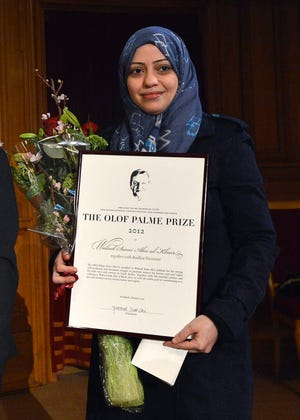 Saudian lawyer and human rights activist Waleed Abu al-Khair's wife, Samar Badawi, receives the Olof Palme prize at the 2nd chamber of the Swedish Parliament in Stockholm in 2013. Saudi Arabia has expelled the Canadian ambassador after Canada's Foreign Ministry criticized human-rights violations in the Islamic kingdom, including the jailed of Badawi.