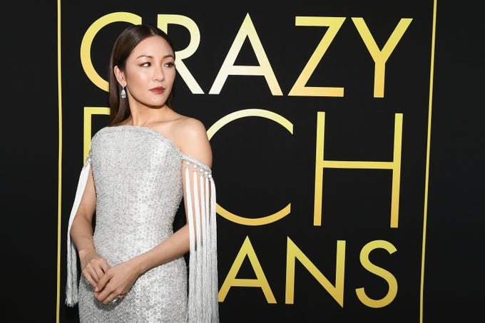 "The fabulous cast of ""Crazy Rich Asians"" shut down the TCL Chinese Theatre with their looks on August 7, 2018 ahead of the film's Aug 15 premiere. Constance Wu will star in the first Hollywood studio film centered on an Asian-American character's story in over 25 years."